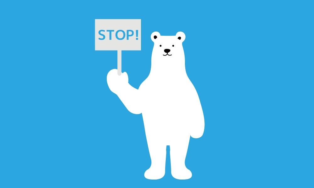 STOP!の看板を持ったシロクマ