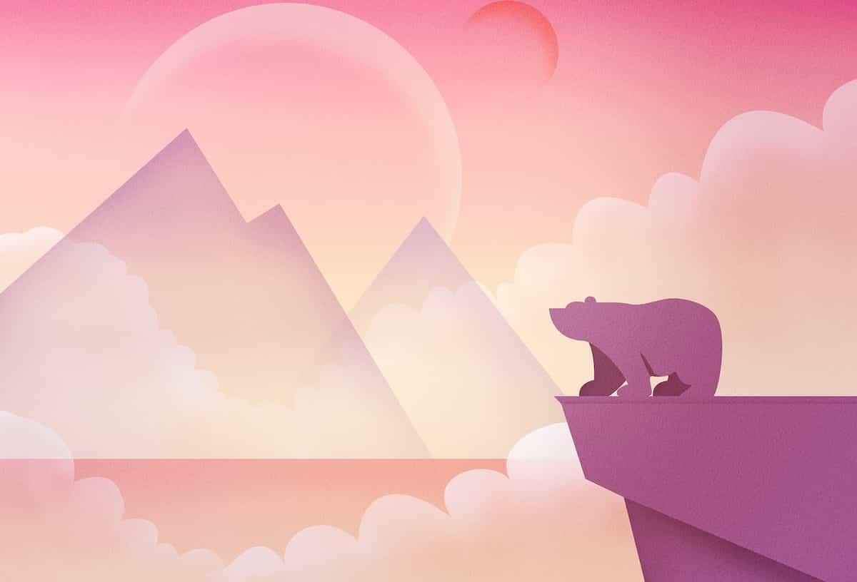 小高い丘から山を眺めるクマ
